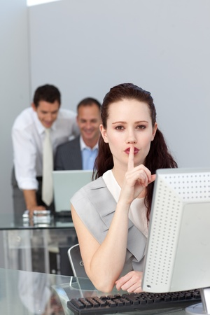 Charming businesswoman asking for silence  photo