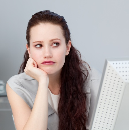 Close-up of a bored businesswoman  Stock Photo - 10077399