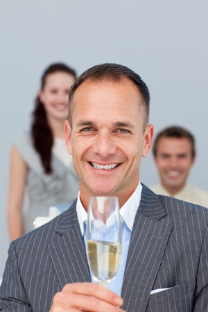 Successful businessman holding Champagne with his team Stock Photo - 10094743
