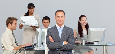 Charismatic manager with folded arms Stock Photo - 10092265
