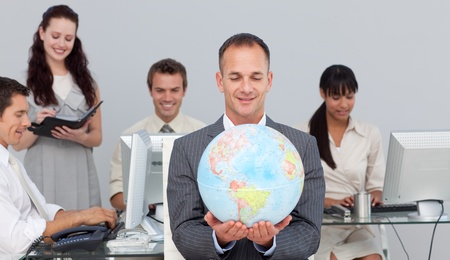 Charsmatic manager smiling at global expansion Stock Photo