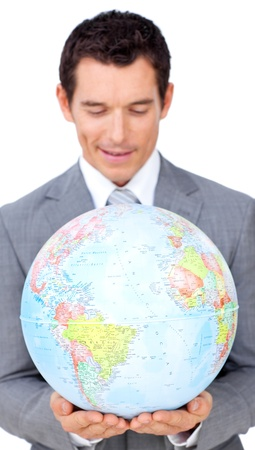 online internet presence: Confident businessman holding a terrestrial globe  Stock Photo