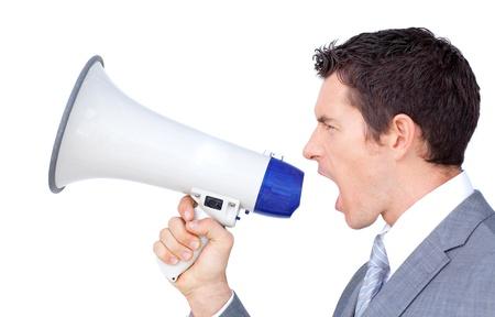 businessman using a megaphone: Portrait of a confident businessman using a megaphone