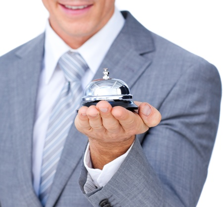 self service: Close-up of a businessman holding a service bell  Stock Photo