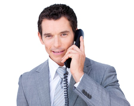 Confident businessman talking on phone  photo