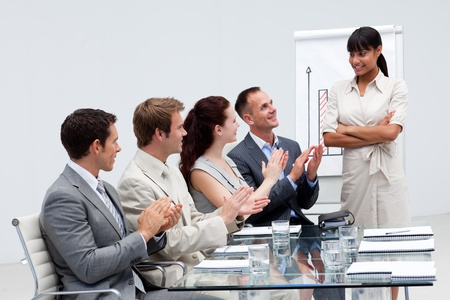 Business people applauding a colleague after reporting to sales figures Stock Photo - 10094103