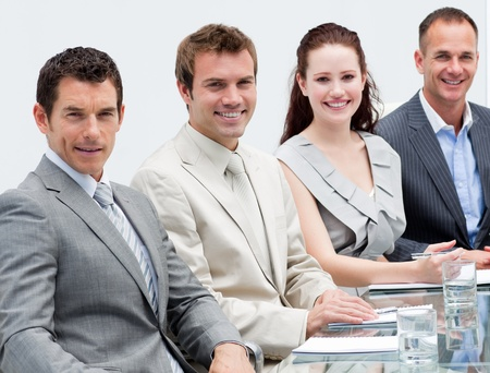 Portrait of business people sitting in a meeting Stock Photo - 10077333
