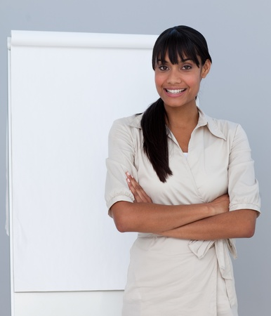 Smiling Afro-American businesswoman giving a presentation  photo