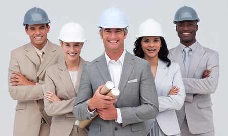 Architectural team smiling at the camera with hard hats photo