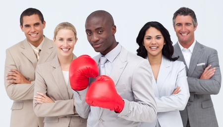 powe: Afro-American businessman with boxing gloves leading his team