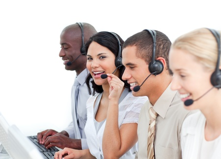 Positive business people working in a call center photo