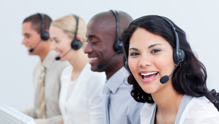 customer service representative: A diverse business team talking on headset  Stock Photo