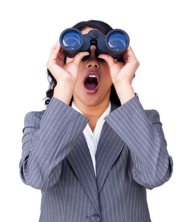Astonished businesswoman looking through binoculars  Stock Photo - 10093547