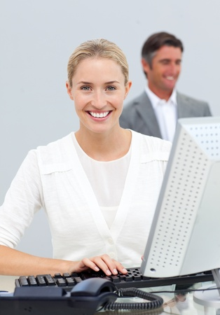 hidef: Smiling businesswoman working at her computer