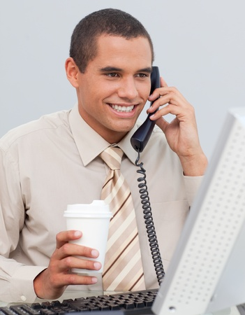 Businessman talking on phone in the office Stock Photo - 10092866