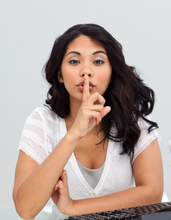 Ethnic businesswoman asking for silence in the office Stock Photo - 10094167