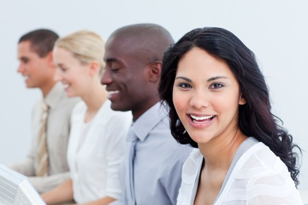 teaming: Brunette businesswoman and her team at work Stock Photo