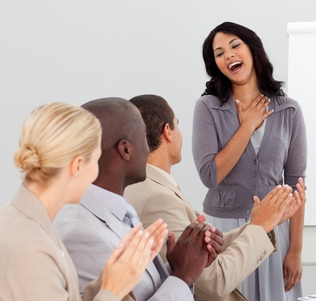 Business people clapping at a presentation photo