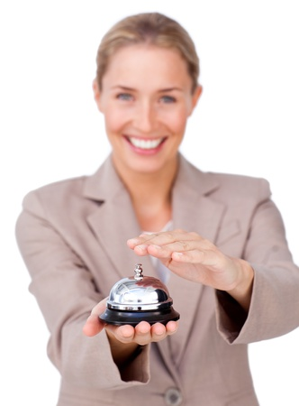 service bell: Smiling businesswoman holding a service bell  Stock Photo