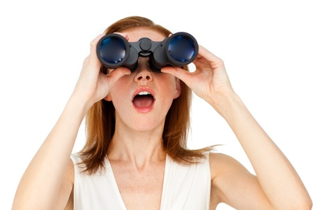 detect: Visionary businesswoman looking through binoculars Stock Photo