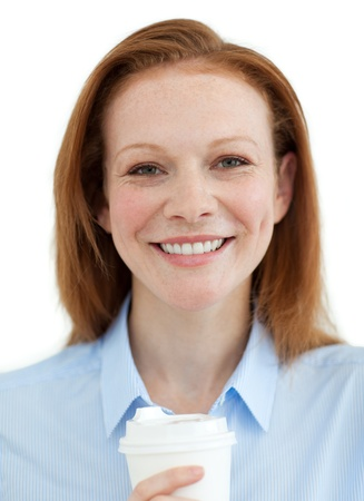 Smiling businesswoman drinking a coffee  photo