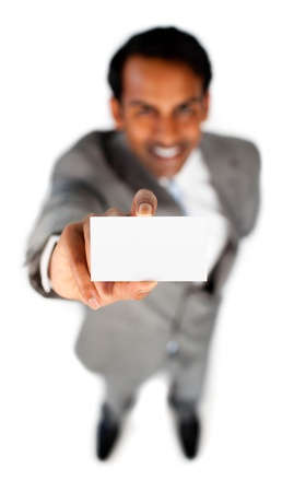 Smiling ethnic businessman holding a white card  Stock Photo - 10076101