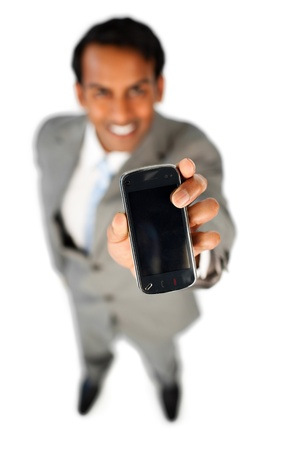 Enthusiastic businessman showing a mobile phone  photo