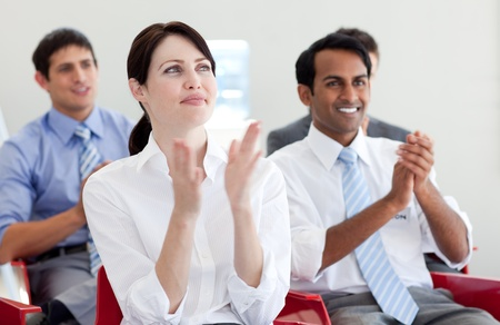 International business people clapping at a conference Stock Photo - 10077323