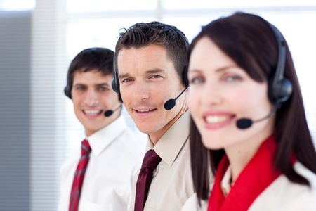 Young business people working in a call center photo