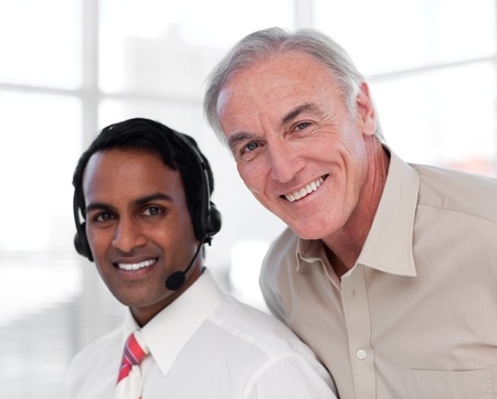 Senior businessman helping his colleague Stock Photo - 10078329