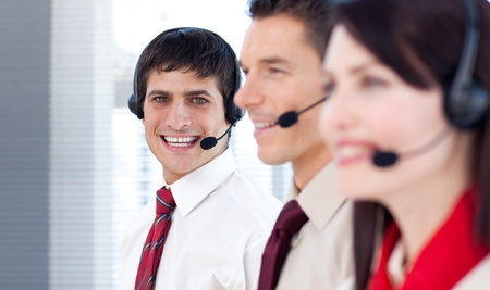 Young business people with headsets on Stock Photo - 10077898