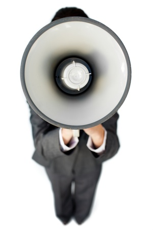 Businesswoman giving instructions with a megaphone  photo
