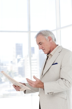 more mature: Portrait of a senior manager reading newspaper Stock Photo
