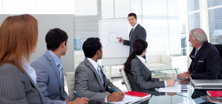 new strategy: Confident manager discussing a new strategy his team