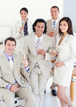Successful business team drinking Champagne Stock Photo - 10093984