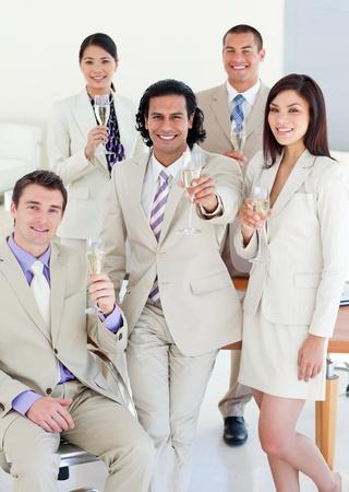 Confident business team celebrating a success photo