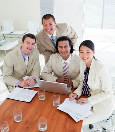 Confident business team having a brainstorming Stock Photo - 10093703