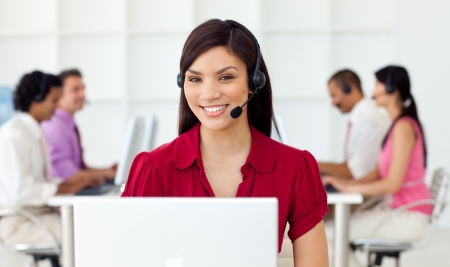 helpdesk: Young Businesswoman using headset  Stock Photo