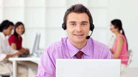 computer support: Assertive businessman using headset