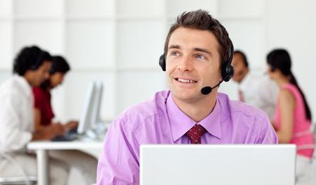 Smiling businessman talking on headset  photo