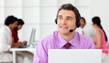 Smiling businessman talking on headset  photo