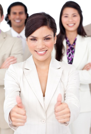 multi national: Attractive businesswoman and her team with thumbs up  Stock Photo