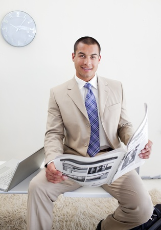 Charming manager reading a newspaper Stock Photo - 10093619