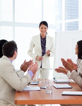 office presentation: Successful asian woman giving a presentation Stock Photo