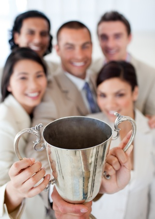 Successful business team showing their throphy photo