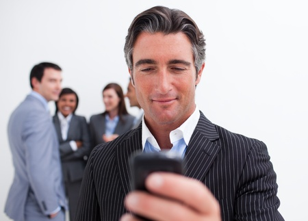 Confident manager sending a text with a mobile phone photo