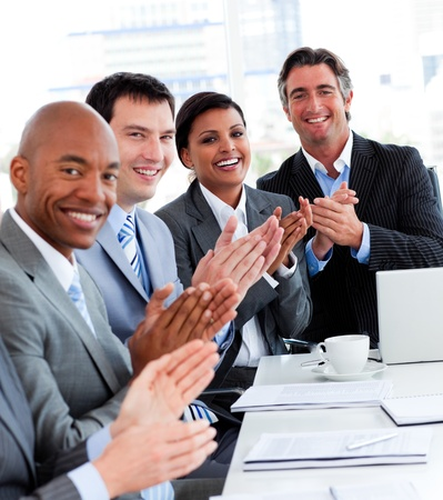 Team of successful multi-ethnic business people applauding Stock Photo - 10078720