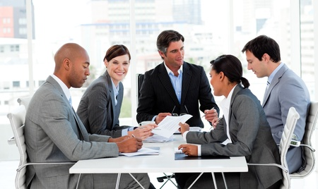 Multi-ethnic business people disscussing a budget plan Stock Photo - 10093717