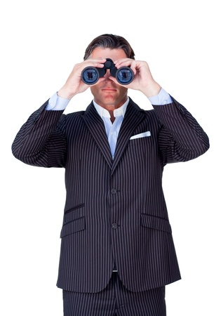 Serious businessman using binoculars  Stock Photo - 10078452