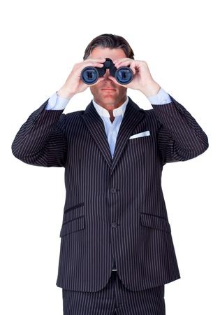 using binoculars: Serious businessman using binoculars